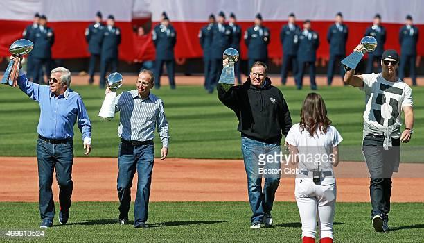 The New England Patriots owners Robert Kraft Jonathan Kraft head coach Bill Belichick and quarterback Tom Brady carry the franchise's four Vince...