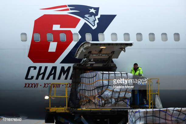 The New England Patriots plane delivers N95 masks from Shenzhen China to Logan International Airport to slow the spread of the coronavirus outbreak...