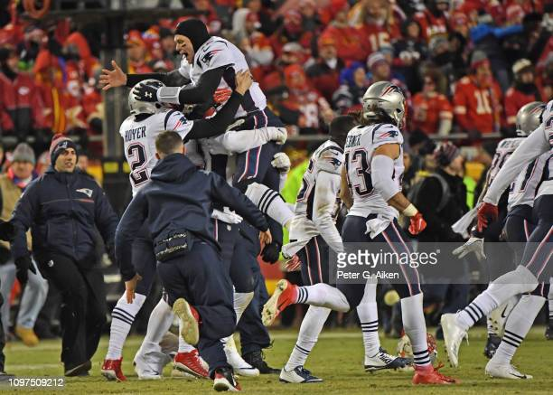 The New England Patriots quarterback Tom Brady celebrate after defeating the Kansas City Chiefs in overtime during the AFC Championship Game at...