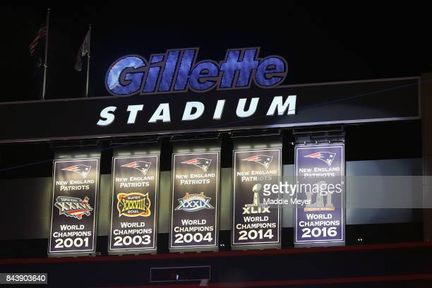 The New England Patriots Super Bowl LI Championship banner is unveiled at Gillette Stadium before the game between the Kansas City Chiefs and the New...