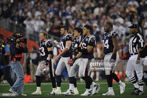 The New England Patriots team captains including Mike Vrabel and Junior Seau of the New England Patriots walk to midfield before Super Bowl XLII...