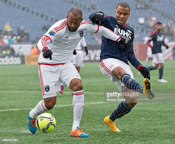 The New England Revolution's Charlie Davies pressures the San Jose Earthquakes' Victor Bernardez during first half action at Gillette Stadium on...
