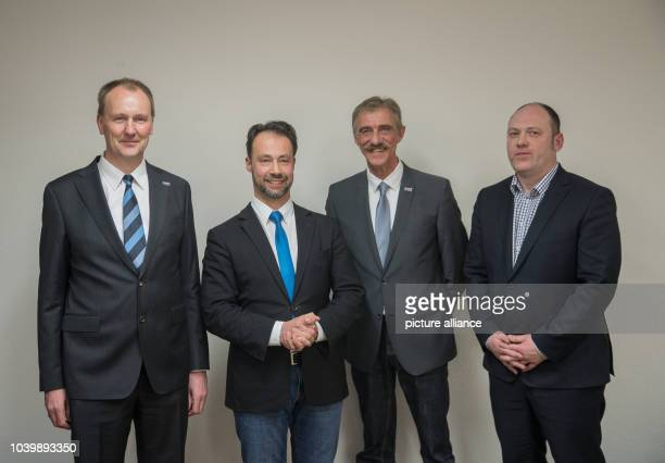 The new executive committe of the AfD party in RhinelandPalatinate with Timo Boehme Jan Bollinger Uwe Junge and Joachim Paul pose for a group photo...
