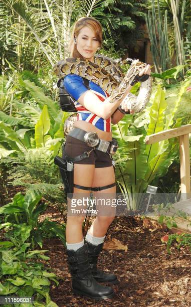 The new face of Lara Croft Karima Adebibe with the help of her Burmese Python at a photocall for the new Tomb Raider Legend game