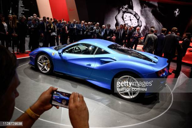 The new Ferrari F8 Tributo is displayed at the booth of Italian carmaker on March 5, 2019 during a press day ahead of the Geneva International Motor...