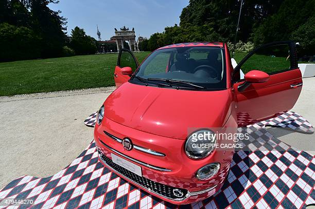 The new Fiat 500 constructed by ItalianUS multinational automobile manufacturer Fiat Chrysler Automobiles is displayed in front of Arco della Pace in...