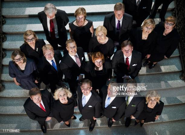 The new Finnish government in Helsinki poses for a familly photo on June 22 2011 Culture and Sports Minister Paavo Arhinmäki Finance Minister Jutta...
