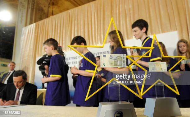 The new fiveeuro banknote are seen after being presented by European Central Bank President Mario Draghi during a press conference following the...