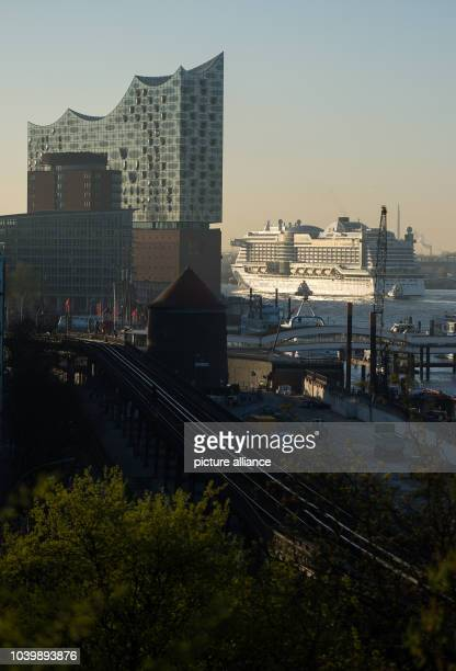The new flagship 'Aidaprima' of shipping company Aida Cruises passes the Elbe Philharmonic Hall as it arrives at the port of Hamburg Germany 21 April...