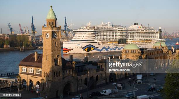 The new flagship 'Aidaprima' of shipping company Aida Cruises passes the St Pauli Piers as it arrives at the port of Hamburg Germany 21 April 2016...