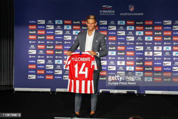 The new football player of Atlético de Madrid Marcos Llorente is seen at Wanda Metropolitano stadium showing his new tshirt of the team on June 28...