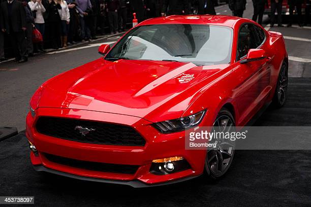 The new Ford Motor Co Mustang is unveiled in Times Square in New York US on Thursday Dec 5 2013 Ford taking its 50year old Mustang global for the...