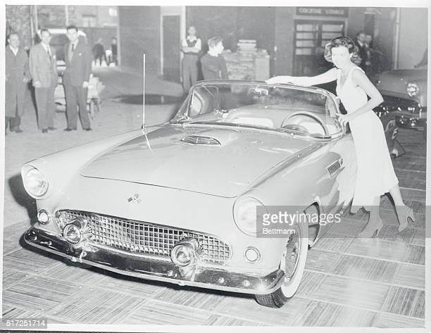 The new Ford Thunderbird sports car has its graceful lines matched by a lovely girl as it goes on display at the London Motor show in Earls Court The...