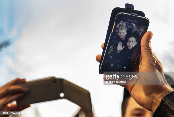 The new Formula 1 world champion Nico Rosberg holds a smartphone and takes a selfie with a fan in Wiesbaden Germany 30 November 2016 Nico Rosberg was...