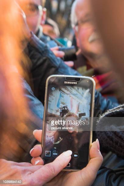 The new Formula 1 world champion Nico Rosberg poses for a picture with a fan in Wiesbaden Germany 30 November 2016 Nico Rosberg was born in Wiesbaden...