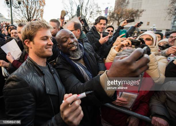 The new Formula 1 world champion Nico Rosberg poses for pictures with fans in Wiesbaden Germany 30 November 2016 Nico Rosberg was born in Wiesbaden...