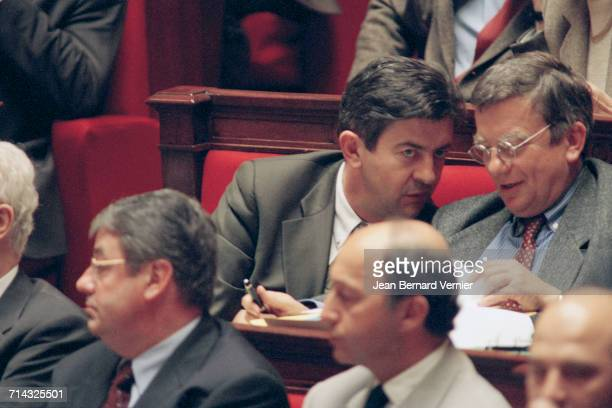 The new French government at the National Assembly Paris 28th March 2000 Front Daniel Vaillant and Laurent Fabius JeanLuc Mélenchon is at back left
