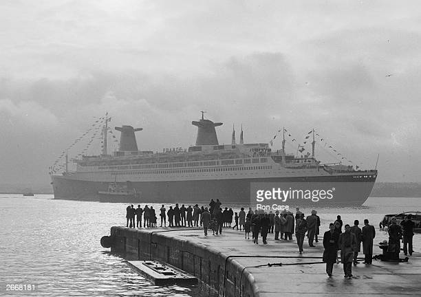 The new French liner France later rebuilt as the cruise ship Norway steams away after completing her docking trials at Southampton