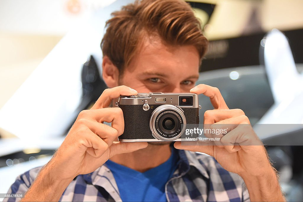 The new Fuji X100T camera with the Fujinon Super EBC f 23 mm lens is presented at the Photokina 2014 trade fair on September 15, 2014 in Cologne, Germany. Photokina is the world's largest trade fair for cameras and photographic equipment.