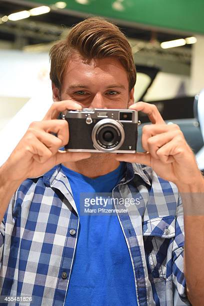 The new Fuji X100T camera with the Fujinon Super EBC f 23 mm lens is presented at the Photokina 2014 trade fair on September 15 2014 in Cologne...