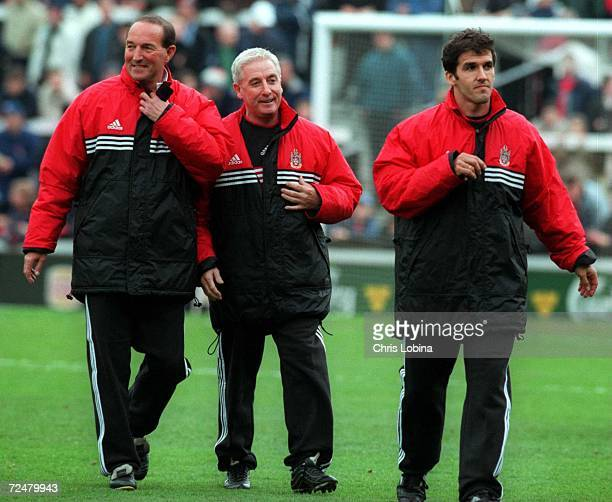 Alan Smith Roy Evans and KarlHeinz Riedler walking to the bench before the match between Fulham v Crystal Palace in the Nationwide League Division...