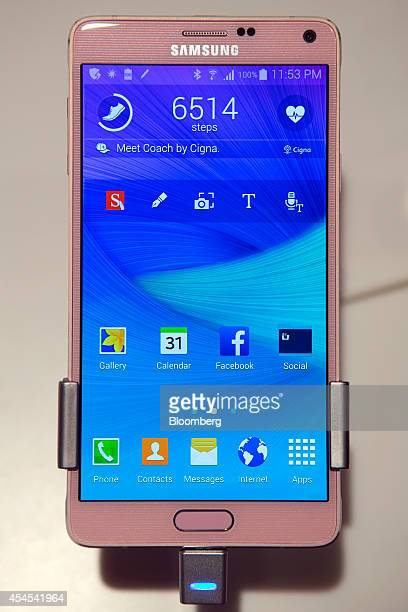 The new Galaxy Note 4 smartphone is displayed for members of the media in New York US on Wednesday Sept 3 2014 Samsung Electronics Co unveiled a pair...