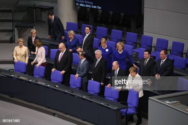 The new German government including German Chancellor Angela Merkel takes its seats on the government bench following its swearingin at the Bundestag...