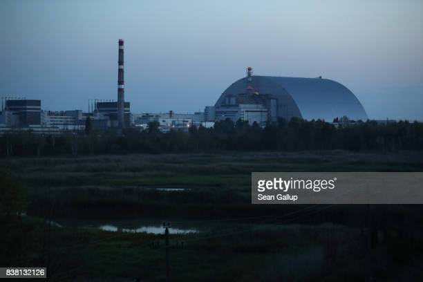 CHORNOBYL' UKRAINE AUGUST 17 The new giant enclosure that encases stricken reactor number four at the Chernobyl nuclear power plant is seen at dusk...
