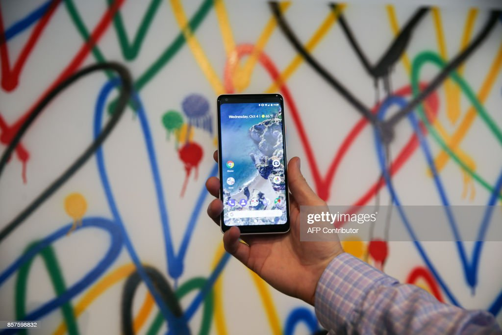 The new Google Pixel 2 XL smartphone is seen at a product launch event, October 4, 2017, at the SFJAZZ Center in San Francisco, California. Google on Wednesday unveiled newly designed versions of its Pixel smartphone, the highlight of a refreshed line of devices which are part of the tech giant's efforts to boost its presence against hardware rivals. The new Pixel 2 and larger Pixel 2 XL are the first Google-made devices since the California tech giant announced the acquisition of key segments of Taiwan-based electronics group HTC PHOTO / Elijah Nouvelage