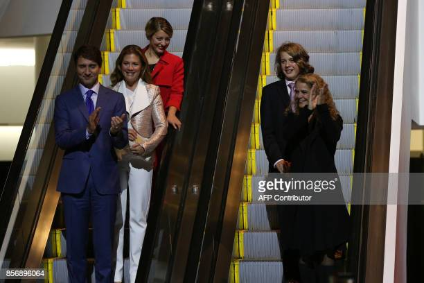 The new Governor General Julie Payette with her son Laurier Payette Flynn Prime Minister Justin Trudeau Sophie Grégoire Trudeau and Minister of...