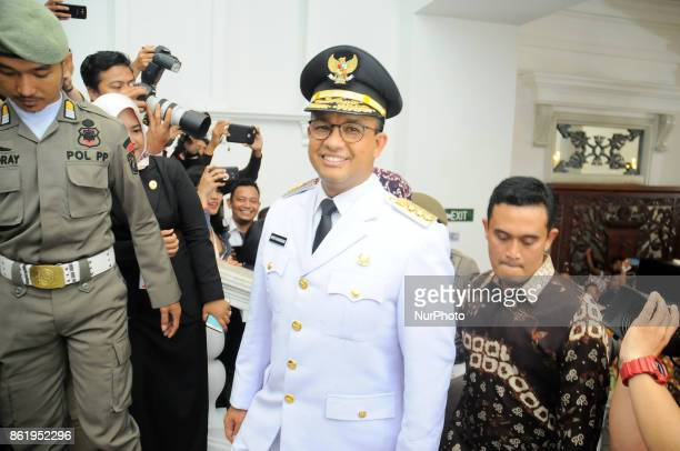 The new Governor of DKI Jakarta Anies Baswedan with supporters happy to be inaugurated and headed to Jakarta City Hall office Indonesia on October...