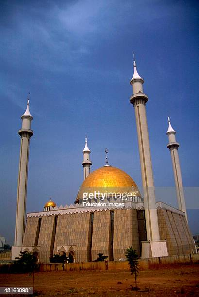 The new Grande Mosque in Abuja Abuja is the capitol of Nigeria and was created by building an entirely new city on a barren plain in the center of...