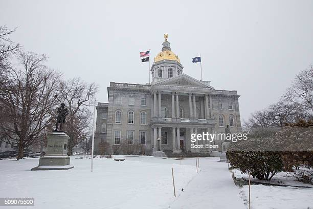 The New Hampshire State House on a snowy day in Concord New Hampshire on February 8 2016 Democratic and Republican Presidential are stumping for...