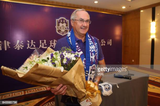 The new head coach of China's Tianjin Teda Uli Stielike attends a press conference on September 11 2017 in Tianjin China