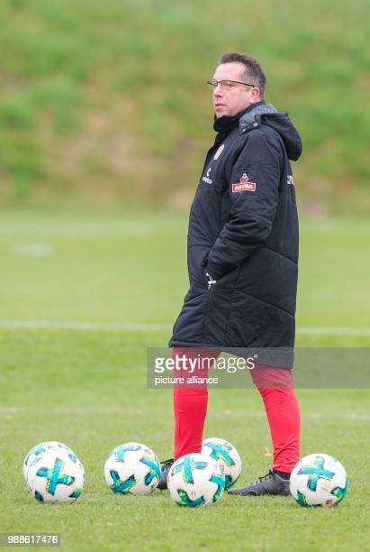The new head coach of the German 2 Bundesliga team FC St Pauli Markus Kauczinski watches his first training session with the team in Hamburg Germany...