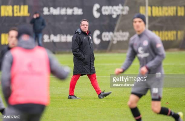 The new head coach of the German 2 Bundesliga team FC St Pauli Markus Kauczinski watches his first training session with the team in Hamburg Germany...