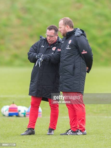 The new head coach of the German 2 Bundesliga team FC St Pauli Markus Kauczinski speaks with his cotrainer Patrick Westermann during his first...