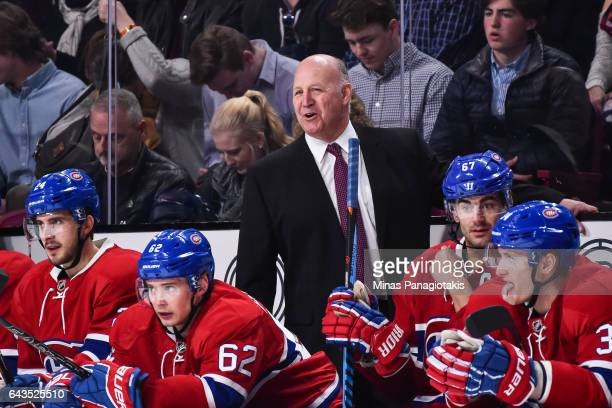 The new head coach of the Montreal Canadiens Claude Julien smiles behind the bench during the NHL game against the Winnipeg Jets at the Bell Centre...