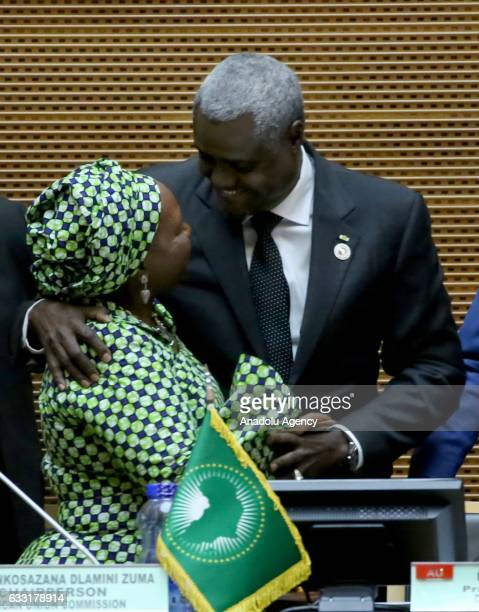 The new head of the AU Commission Chadian Foreign Minister Moussa Faki Mahamat hugs former chairperson Nkosazana Dlamini Zuma before singing the...