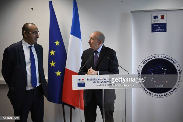 The new head of the DGSI Laurent Nunez listens to Interior Minister Gerard Collomb delivering a speech at the DGSI heaquarters in LevalloisPerret on...