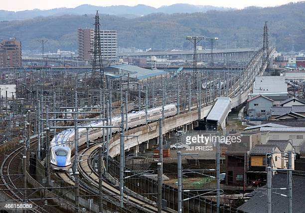 The new Hokuriku 'shinkansen' or bullet train bound for Tokyo heads out of Kanazawa station in Ishikawa prefecture as a new service is launched on...