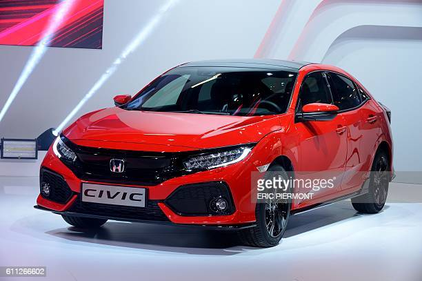 The new Honda Civic is presented during a Press Conference on the press days of the Paris motor Show on September 29, 2016. / AFP / ERIC PIERMONT