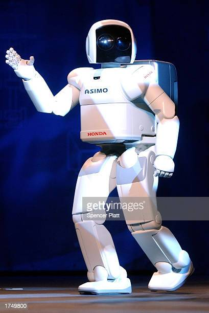 The new Honda robot ASIMO walks on stage during a North American educational tour designed to introduce the public to ASIMO and to encourage students...