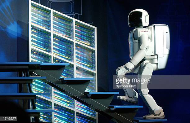 The new Honda robot ASIMO walks up stairs during a North American educational tour designed to introduce the public to ASIMO and to encourage...