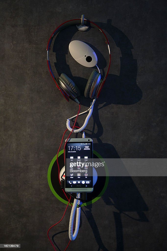 The new HTC One smartphone sits on display alongside a set of headphones during a launch event in London, U.K., on Tuesday, Feb. 19, 2013. HTC Corp. introduced its new flagship HTC One smartphone at a launch event in London today. Photographer: Simon Dawson/Bloomberg via Getty Images