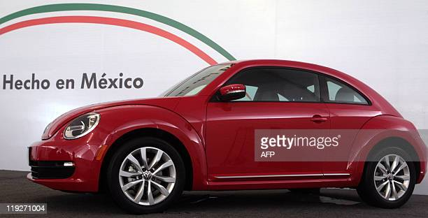 The new incarnation of Volkswagen's iconic car the 'Beetle' is presented to the media at the auto factory in Puebla State Mexico on July 15 2011 AFP...