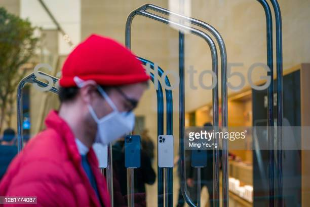 The new iPhone 12 and iPhone 12 Pro on display in the window of the Apple Store on Regent Street on October 23, 2020 in London, England. Apple's...