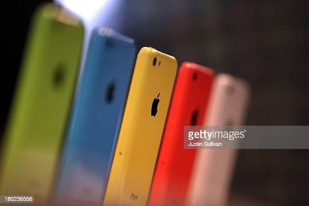 The new iPhone 5C is displayed during an Apple product announcement at the Apple campus on September 10 2013 in Cupertino California The company...