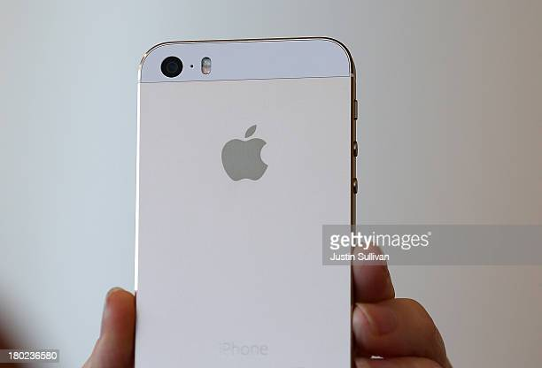The new iPhone 5S is displayed during an Apple product announcement at the Apple campus on September 10 2013 in Cupertino California The company...