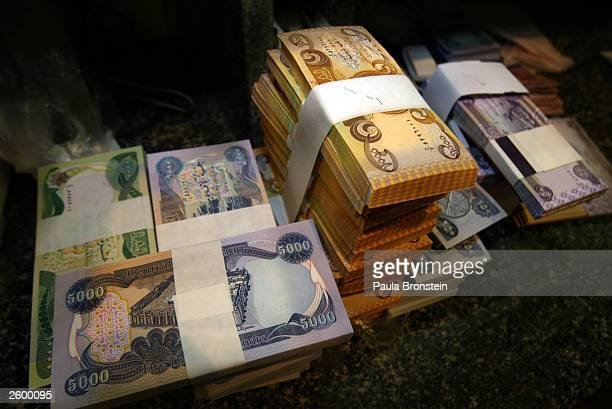The new Iraqi dinar banknotes are shown on the counter ready for distribution at the Bank of Baghdad October 15 2003 in Baghdad as the currency is...